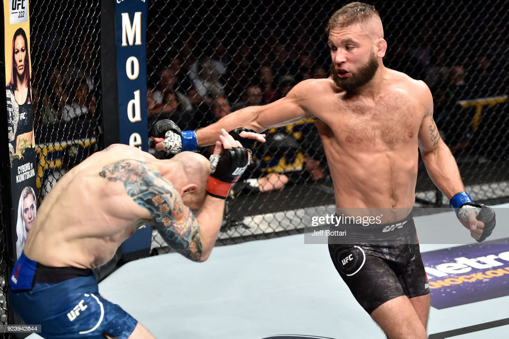 Jeremy Stephens throws a spinning back fist against Josh Emmett in their featherweight bout during the UFC Fight Night event at Amway Center on February 24, 2018 in Orlando, Florida.
