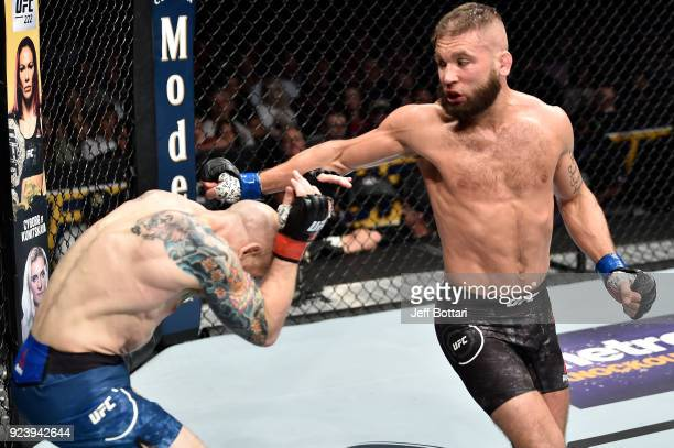 Jeremy Stephens throws a spinning back fist against Josh Emmett in their featherweight bout during the UFC Fight Night event at Amway Center on...