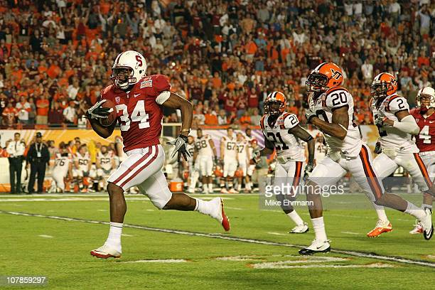 Jeremy Stewart of the Stanford Cardinal runs for a 6yard touchdow in the first quarter against Jayron Hosley and Rashad Carmichael of the Virginia...