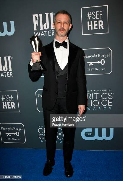 Jeremy Strong poses in the press room with the Best Actor in a Drama Series award for 'Succession' during the 25th Annual Critics' Choice Awards at...