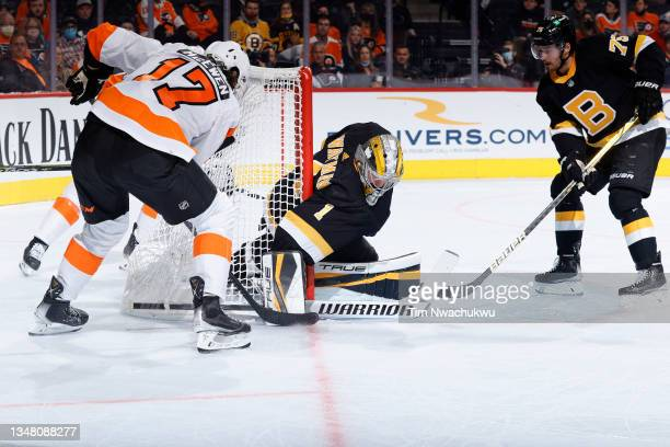 Jeremy Swayman of the Boston Bruins blocks a shot by Zack MacEwen of the Philadelphia Flyers at Wells Fargo Center on October 20, 2021 in...