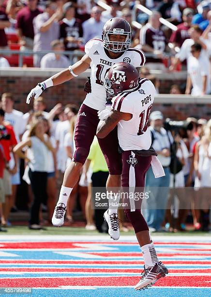 Jeremy Tabuyo and Edward Pope of the Texas AM Aggies celebrate after Tabuyo scored on a 30yard touchdown pass during the first half of their game...