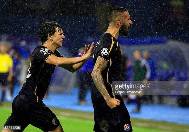 ZAGREB CROATIA AUGUST 25 Jeremy Taravel of Dinamo Zagreb celebrates scoring the goal with the Ante Coric during the UEFA Champions League Qualifying...