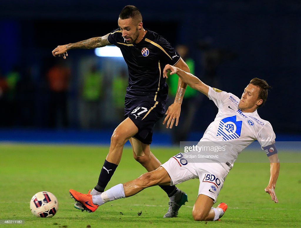 Jeremy Taravel (L) of FC Dinamo Zagreb is challenged by Mattias Mostrom (R) of FC Molde during the UEFA Champions League Third Qualifying Round 1st Leg match between FC Dinamo Zagreb and FC Molde at Maksimir stadium in Zagreb, Croatia on Tuesday, July 28, 2015.