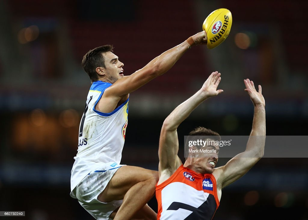 Jeremy Taylor of the Suns punches ahead of Jeremy Cameron of the Giants during the round two AFL match between the Greater Western Sydney Giants and the Gold Coast Suns at Spotless Stadium on April 1, 2017 in Sydney, Australia.