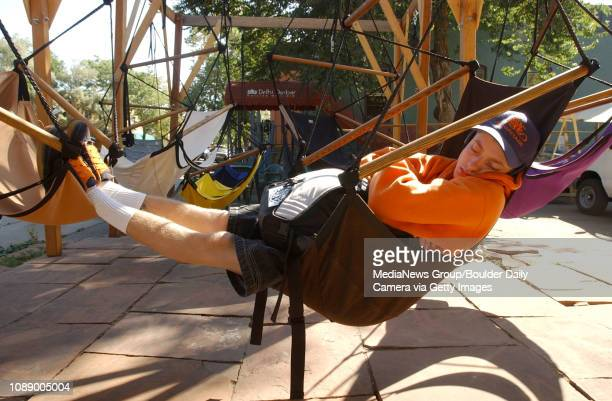 Jeremy Thompson naps in a Sky Chair in a display at the company's headquarters in downtown Boulder Wednesday morning
