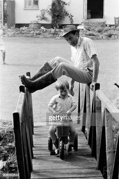 Jeremy Thorpe holidaying at home at his thatched cottage near Cobbaton Umberleigh Devon Pictured Jeremy Thorpe forms a bridge for his son Rupert to...