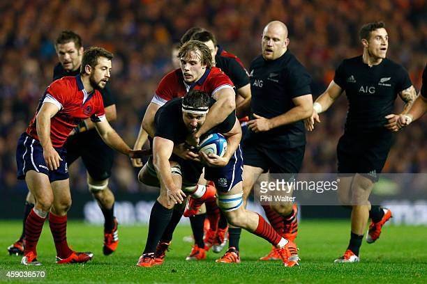 Jeremy Thrush of the All Blacks is tackled during the Viagogo Autumn International match between Scotland and New Zealand at Murrayfield Stadium on...