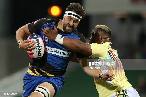 Jeremy Thrush of the Force runs the ball against Tau Kolomatangi of the Tigers during the Global Rapid Rugby match between the Western Force and...