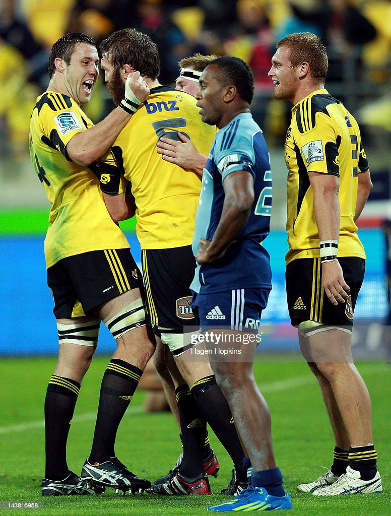 Jeremy Thrush of the Hurricanes (L) congratulates Jason Eaton on his try during the round 11 Super Rugby match between the Hurricanes and the Blues at Westpac Stadium on May 4, 2012 in Wellington, New Zealand.