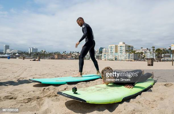 Jeremy Toljan and Maximilian Philipp of Borussia Dortmund are getting a surf lesson at the Venice Beach during Borussia Dortmund's USA Training Camp...
