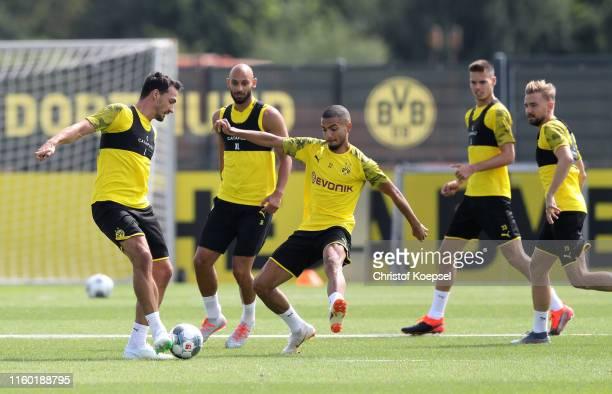 Jeremy Toljan challenges Mats Hummels during a Borussia Dortmund training session at Training Ground Brackel on July 05, 2019 in Dortmund, Germany....