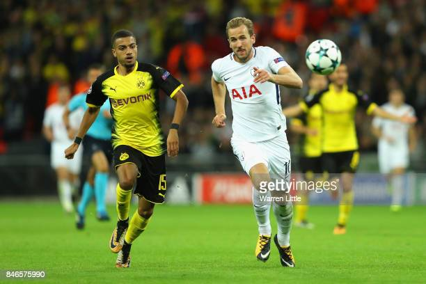 Jeremy Toljan of Borussia Dortmund and Harry Kane of Tottenham Hotspur battle for possession during the UEFA Champions League group H match between...