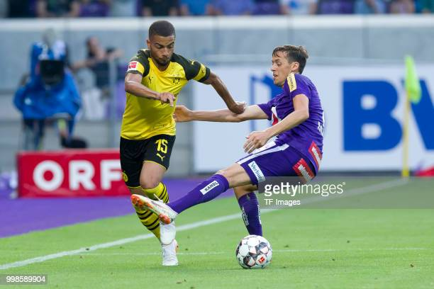 Jeremy Toljan of Borussia Dortmund and Uros Matic of Austria Wien battle for the ball during the friendly match between Austria Wien and Borussia...
