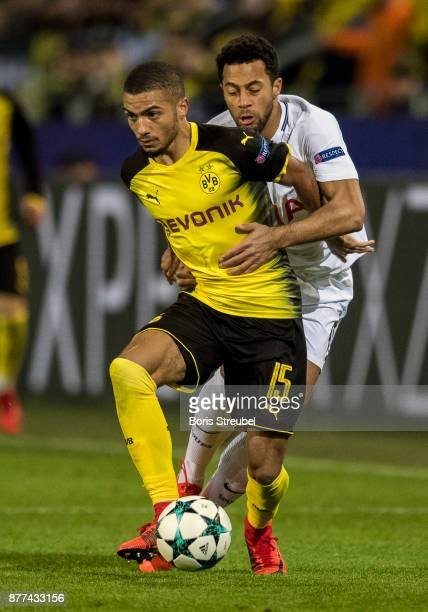 Jeremy Toljan of Borussia Dortmund is challenged by Mousa Dembele of Tottenham Hotspurduring the UEFA Champions League group H match between Borussia...