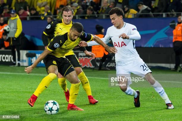 Jeremy Toljan of Borussia Dortmund Mario Goetze of Borussia Dortmund and Dele Alli of Tottenham Hotspur battle for the ball during the UEFA Champions...