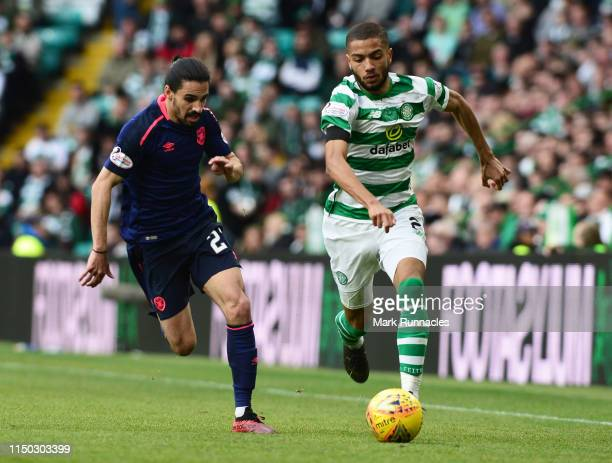 Jeremy Toljan of Celtic is chased by Ryan Edwards of Hearts during the Ladbrokes Scottish Premiership match between Celtic and Hearts at Celtic Park...