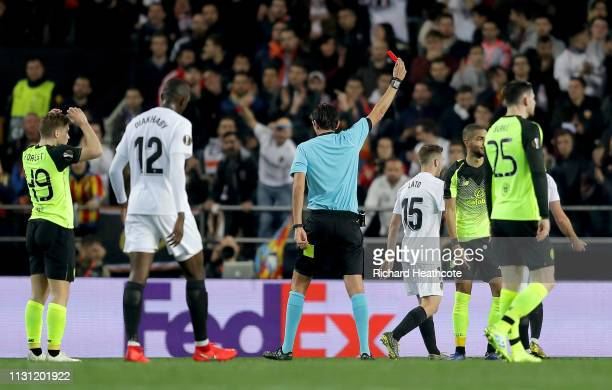 Jeremy Toljan of Celtic is sent off after his second yellow card during the UEFA Europa League Round of 32 Second Leg match between Valencia v Celtic...