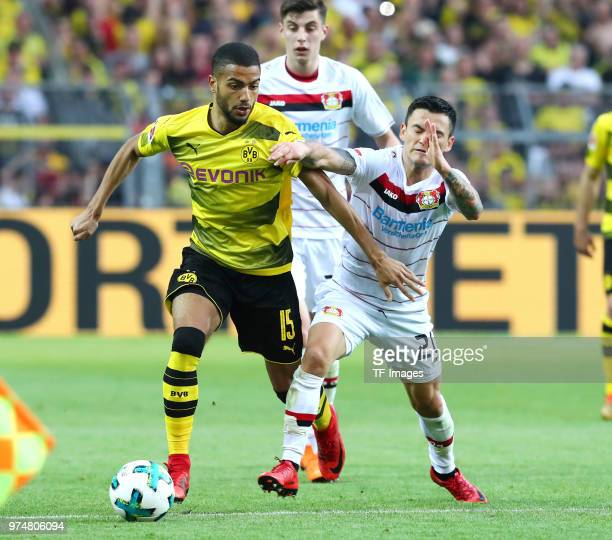 Jeremy Toljan of Dortmund and Charles Aranguiz of Leverkusen battle for the ball during the Bundesliga match between Borussia Dortmund and Bayer 04...