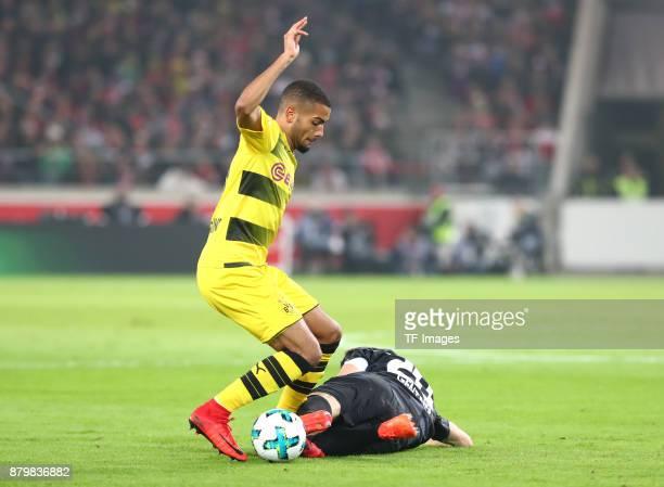 Jeremy Toljan of Dortmund and Christian Gentner of Stuttgart battle for the ball during the Bundesliga match between VfB Stuttgart and Borussia...
