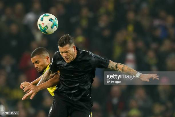Jeremy Toljan of Dortmund and Daniel Ginczek of Stuttgart battle for the ball during the Bundesliga match between VfB Stuttgart and Borussia Dortmund...