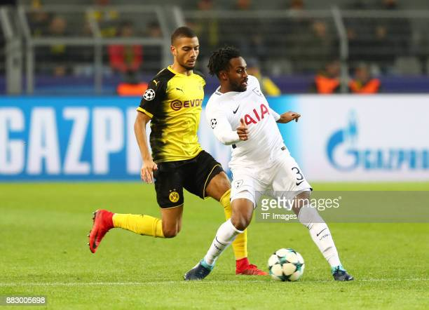 Jeremy Toljan of Dortmund and Danny Rose of Tottenham battle for the ball during the UEFA Champions League group H match between Borussia Dortmund...