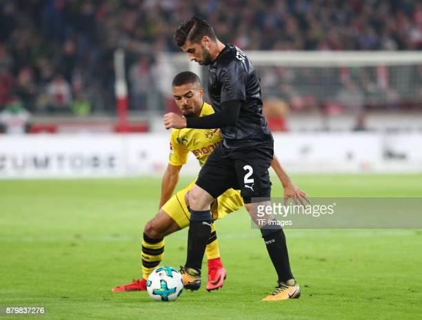 Jeremy Toljan of Dortmund and Emiliano Insua of Stuttgart battle for the ball during the Bundesliga match between VfB Stuttgart and Borussia Dortmund...