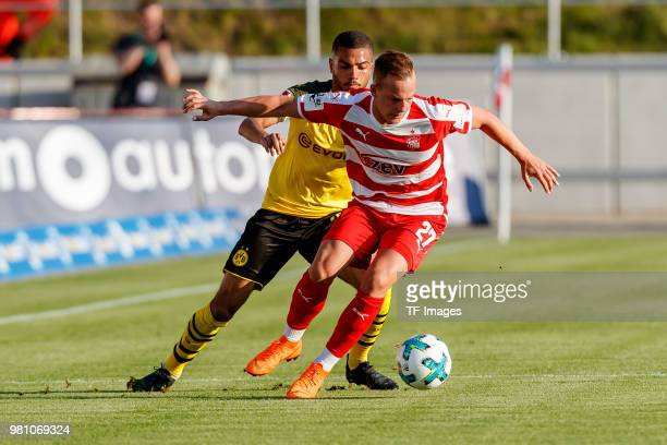 Jeremy Toljan of Dortmund and Fabian Schnabel of Zwickau battle for the ball during the Friendly Match match between FSV Zwickau and Borussia...