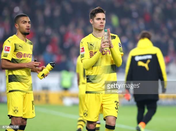 Jeremy Toljan of Dortmund and Julian Weigl of Dortmund look dejected after the Bundesliga match between VfB Stuttgart and Borussia Dortmund at...