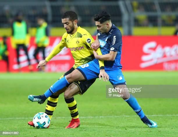 Jeremy Toljan of Dortmund and Nadiem Amiri of Hoffenheim battle for the ball during the Bundesliga match between Borussia Dortmund and TSG 1899...