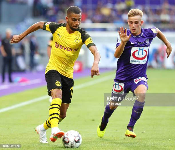 Jeremy Toljan of Dortmund and Niels Hahn of Austria Wien battle for the ball during the friendly match between Austria Wien and Borussia Dortmund at...
