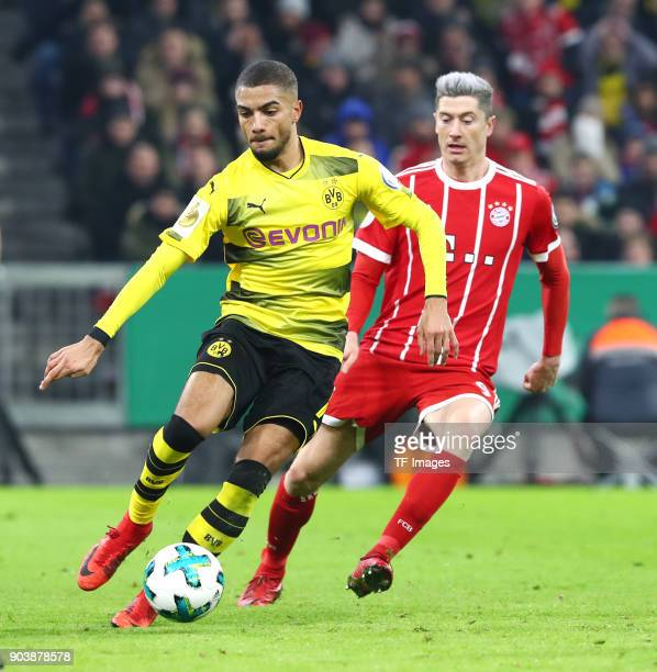 Jeremy Toljan of Dortmund and Robert Lewandowski of Muenchen battle for the ball during the DFB Cup match between Bayern Muenchen and Borussia...