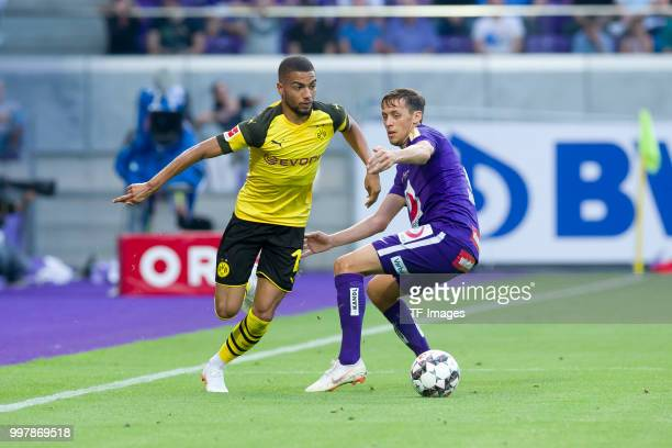 Jeremy Toljan of Dortmund and Uros Matic of Austria Wien battle for the ball during the friendly match between Austria Wien and Borussia Dortmund at...