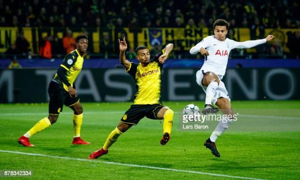 Jeremy Toljan of Dortmund challenges Dele Alli of Tottenham during the UEFA Champions League group H match between Borussia Dortmund and Tottenham...