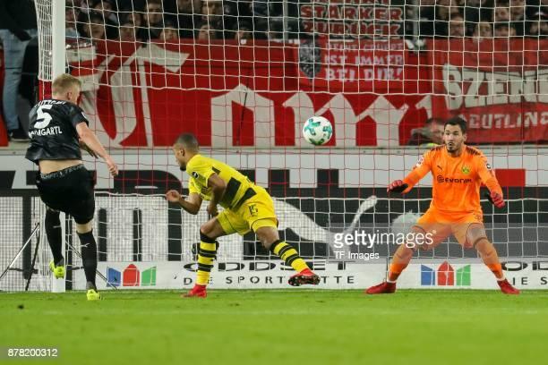 Jeremy Toljan of Dortmund Goalkeeper Roman Buerki of Dortmund and Timo Baumgartl of Stuttgart battle for the ball during the Bundesliga match between...