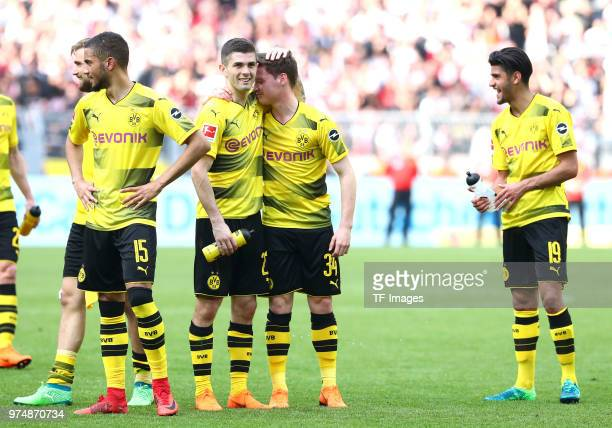 Jeremy Toljan of Dortmund Julian Weigl of Dortmund and Sergio Gomez of Dortmund Mahmoud Dahoud of Dortmund celebrate after winning the Bundesliga...