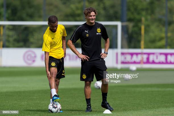 Jeremy Toljan of Dortmund speak with Assistant coach Edin Terzic of Dortmund during a training session at BVB trainings center on July 9 2018 in...