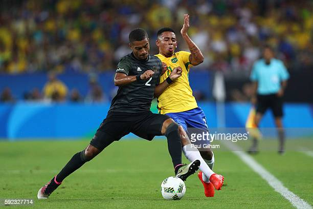 Jeremy Toljan of Germany and Gabriel Jesus of Brazil during the Men's Football Final between Brazil and Germany at the Maracana Stadium on Day 15 of...