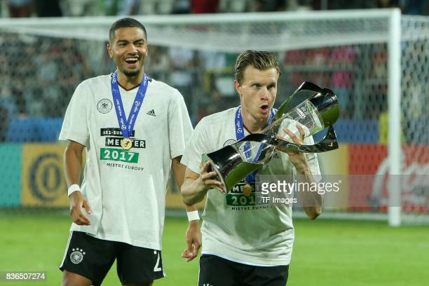 Jeremy Toljan of Germany Yannick Gerhardt of Germany celebrates with the trophy after the UEFA U21 Final match between Germany and Spain at Krakow...