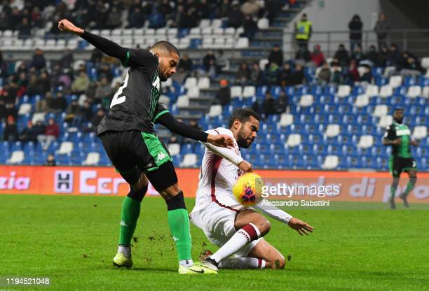 Jeremy Toljan of US Sassuolo competes for the ball with Koffi Djidji of Torino FC during the Serie A match between US Sassuolo and Torino FC at Mapei...