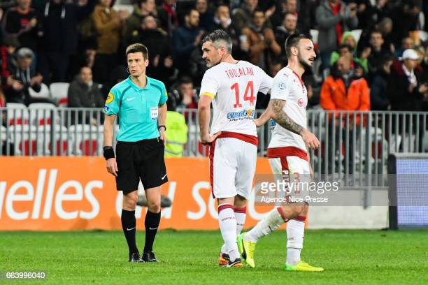 Jeremy Toulalan and Diego Contento of Bordeaux and referee Benoit Bastien during the French Ligue 1 match between Nice and Bordeaux at Allianz Rivera...