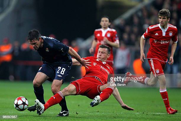 Jeremy Toulalan of Lyon is challenged by Ivica Olic of Bayern during the UEFA Champions League semi final first leg match between FC Bayern Muenchen...