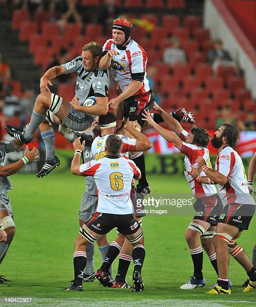 Jeremy Trush of the Hurricanes wins the lineout ball from Franco van der Merwe of the Lions during the 2012 Super Rugby match between MTN Lions and...
