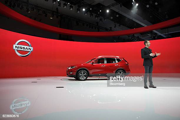 Jeremy Tucker vice president of marketing communication media for Nissan North America unveils the Rogue sports utility vehicle during Automobility...