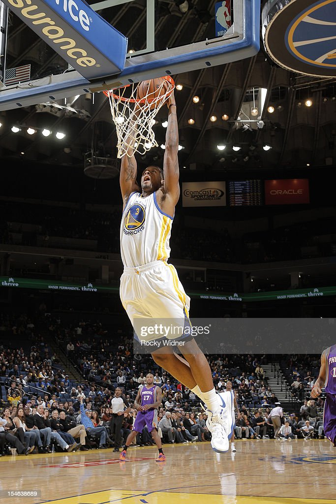 Jeremy Tyler #3 of the Golden State Warriors dunks the ball against the Phoenix Suns during a pre-season game on October 23, 2012 at Oracle Arena in Oakland, California.