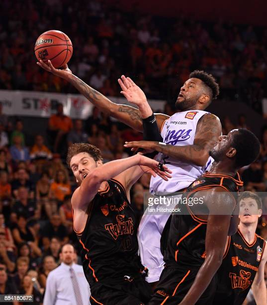 Jeremy Tyler of the Kings attempts a lay up over Alex Loughton of the Taipans during the round eight NBL match between the Cairns Taipans and the...