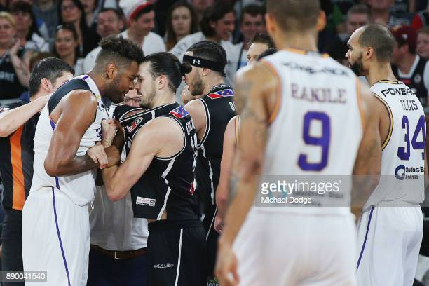 Jeremy Tyler of the Kings comes to grips with Chris Goulding of United after a contest during the round nine NBL match between Melbourne United and...