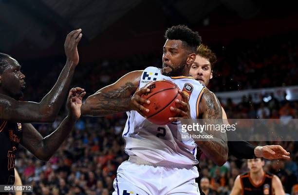Jeremy Tyler of the Kings contests the ball with Alex Loughton and Jerry Evans Jr of the Taipans during the round eight NBL match between the Cairns...