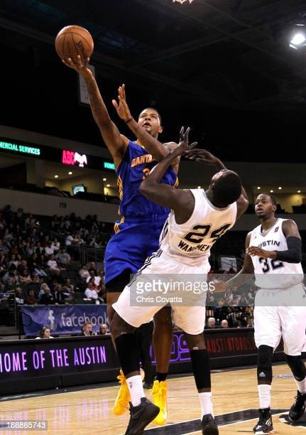 Jeremy Tyler of the Santa Cruz Warriors shoots over Alexis Wangmene of the Austin Toros in game one of the semifinals of the 2013 NBA Development...