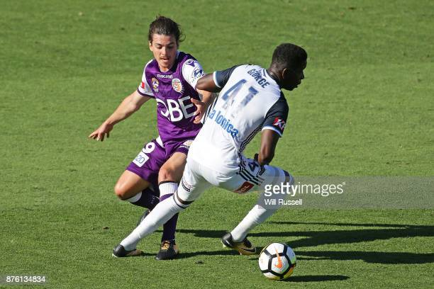 Jeremy Walker of the Glory and Leroy George of the Victory contest the ball during the round seven ALeague match between Perth Glory and Melbourne...